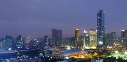 The CITIC Plaza and Tianhe Sports Center Guangzhou dusk 11-5-2008.png