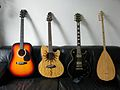 Guitar collection - folk guitar, steel-string single-cutaway guitar, Les Paul model, and Turkish saz (2008-09-08 11.04.49 by Sibe Kokke).jpg