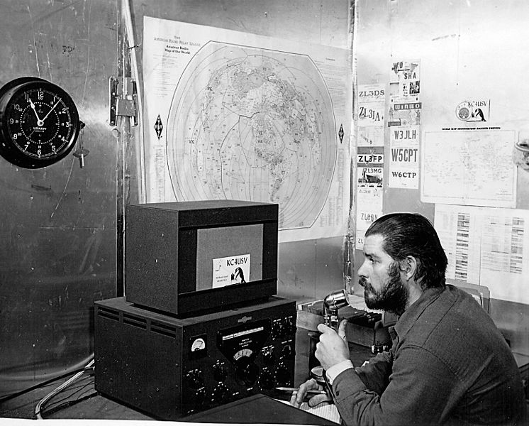 U.S. Navy Chief Petty Officer Adrey Garret uses a ham radio at Williams Air Operating Facility during the 1956 winter