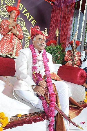 "Dhar State - The current head of the former ruling family, the self-coronated Maharaja Shrimant Hemendra Singh Rao Pawar of Dhar State seated on the Gadi (throne)  of the Kshatriya Maratha-Rajput Pawar (Puar/Parmar) Clan at his ""coronation"" on 15th January 2015 at the 300-year-old 'Rajwada' (Old Palace) of Dhar."