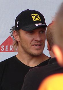 A man wearing a black shirt and hat.