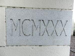 Alex Giualini Plaza - Stone showing construction date