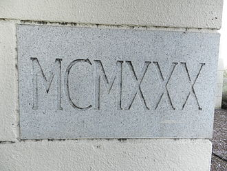Alex Giualini Plaza - Stone showing construction date