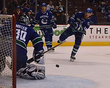 561e86c6de7 Ryan Miller with Henrik and Daniel Sedin warming up prior to a game in the  2014–15 season. Miller was acquired as a free agent in July 2014.