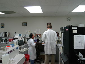 Medical laboratory - Clinical laboratory in a Hospital setting with two technologists shown.