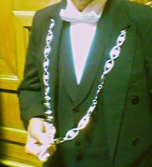 "Huissier - The chain of a huissier in the French Senate. Note also the peculiar ""broken collar""."