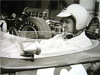 Denny Hulme - Hulme sitting in his car before the 1965 German Grand Prix