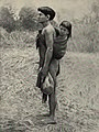 Igorrote mode of carrying children and human heads.jpg