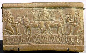 Impression of an Akkadian cylinder seal with inscription The Divine Sharkalisharri Prince of Akkad Ibni-Sharrum the Scribe his servant.jpg