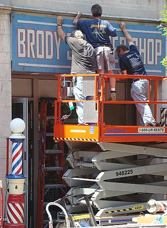 Indiana Jones and the Kingdom of the Crystal Skull - The production crew converts a storefront in downtown New Haven, Connecticut, to be used in a scene set in the 1950s.