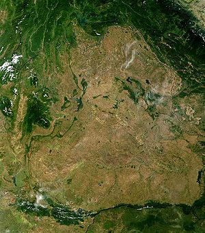 Isan - Satellite image of Isan: the borders with Laos and Cambodia can be seen due to the greater deforestation within Isan.