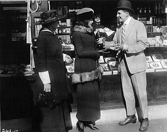 It Pays to Advertise (1919 film) - Lois Wilson (center) and Bryant Washburn in It Pays to Advertise