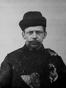 https://upload.wikimedia.org/wikipedia/commons/thumb/0/00/Ivan_Kalyayev.jpg/220px-Ivan_Kalyayev.jpg