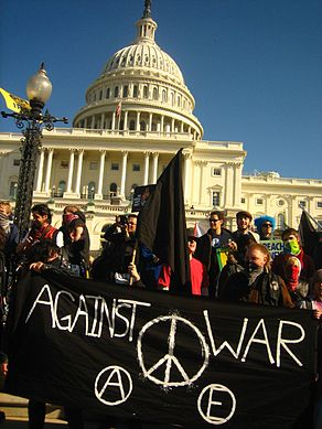 J27 black bloc at US Capitol with black banner.jpg