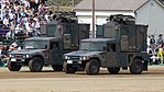 JGSDF High Mobility Vehicle(06-7521, 06-7523) with shelter of JMRC-C6-B left front view at Camp Itami October 8, 2017 01.jpg