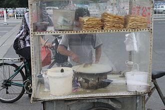 Jianbing - Jianbing being prepared by a street vendor