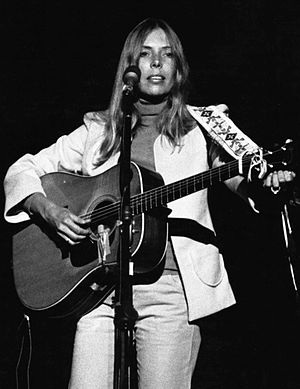 """This Guitar (Can't Keep from Crying) - Like Harrison with """"This Guitar (Can't Keep from Crying)"""", Canadian singer Joni Mitchell responded to detractors with a musical response targeted at their past criticism; photo by Paul C. Babin"""