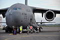 Josh Michal, left, with the U.S. Defense Attache Office, rushes to a U.S. Air Force C-17 Globemaster III aircraft Nov. 11, 2013, during Kiwi Flag as part of Southern Katipo 2013 at Royal New Zealand Air 131111-F-FB147-071.jpg