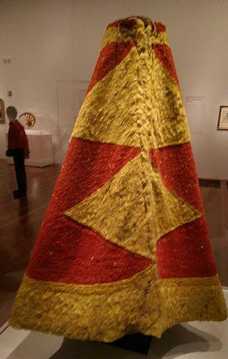 ʻAhu ʻula - A feathered cloak associated with Hawaiian monarch Kalaniʻōpuʻu, on display at the de Young Museum in San Francisco