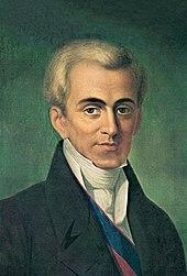 Pictură în ulei reprezentând portretul lui Ioánnis Kapodístrias cu față de trei sferturi, aer auster, poartă o redingotă, un guler rupt și un volan