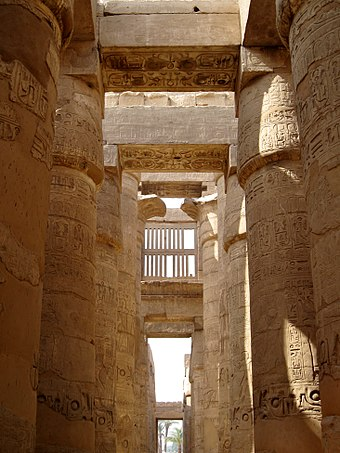 Karnak temple's hypostyle halls are constructed with rows of thick columns supporting the roof beams. Karnak Tempel Hypostyl 05.jpg