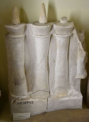 Hawara - Labyrinth, fire altar. Part of a limestone frieze, model of lamps on a stand. 12th Dynasty. From Hawara, Fayum, Egypt. The Petrie Museum of Egyptian Archaeology, London