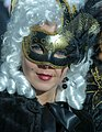 Lady with a black mask (8493220771).jpg