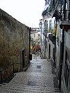 Lane in the old district Alfama Lisbon.jpg