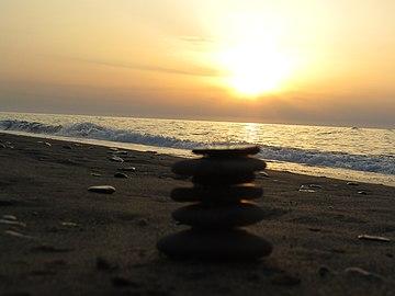 Le coucher de soleil à la plage Mzair jijel.jpg
