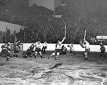 Red Wings and Maple Leaf game during the 1942 Stanley Cup Finals, with Maple Leafs players celebrating moments after scoring a goal.