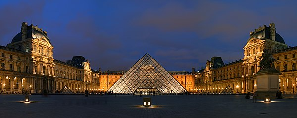 Courtyard of Museum of Louvre, at night, with the Pyramid prominently displayed at centre