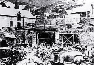 Lyttelton Rail Tunnel - Lyttelton portal of the rail tunnel with construction workers in 1867.