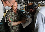 MSG James Ashcom, of the 442nd Air Expeditionary Advisory Squadron, oversees an on-the-job training session between Afghan air force maintenance personnel at Kandahar Air Base.jpg
