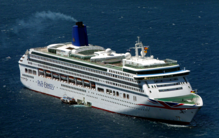 P&O Cruises MV Aurora at anchor in the Santorini basin.