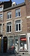 foto van Huis met lijstgevel, waarvan de eerste verdieping in de zgn. Maaslandse renaissance.