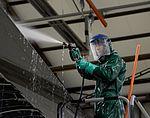 Maintainers clean before painting, inspecting 160104-F-EN010-036.jpg
