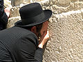 Man praying at the Western Wall.jpg