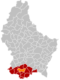 Map of Luxembourg with Mondercange highlighted in orange, the district in dark grey, and the canton in dark red