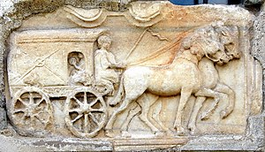 Virunum - Carriage (to the underworld?) from a Roman tomb at Virunum. Today on the south wall of Maria Saal village church