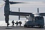 Marines board an MV-22 Osprey aircraft aboard the flight deck of USS Bataan. (32611064595).jpg