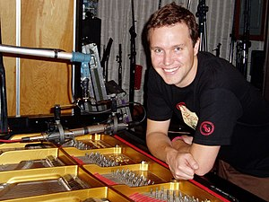 Blink-182 (album) - Bassist Mark Hoppus beside a grand piano while recording the album at Conway Recording Studios in September 2003.