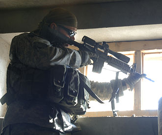 Marksman - An American marksman looks for enemy activity along the hilltops near Dur Baba District, Afghanistan (2006)