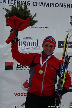 Marte Reenaas with gold (long distance at Ski-EOC 2010).jpg