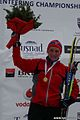 Marte Reenaas with gold (long distance at Ski-EOC 2010).jpg