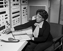 Mary Jackson sitting, adjusting a control on an instrument