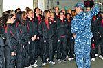 Mass Communication Specialist 1st Class Kurt Riggs greets the U.S. Women's National Soccer Team.jpg