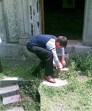 Animal sacrifice - Matagh of a rooster at the entrance of a monastery church (Alaverdi, Armenia, 2009), with inset of bloody steps.