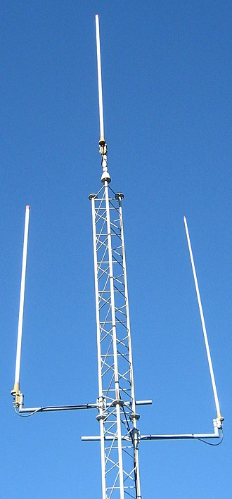 Whip antenna - Three large fiberglass whips mounted on a mast.