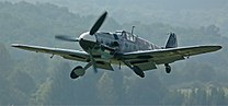 A Messerschmitt Bf 109 figher plane in flight
