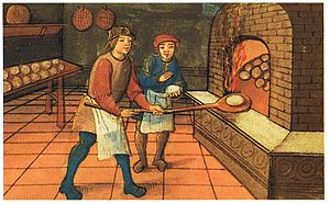 History of breakfast - A medieval baker with his apprentice. As seen in the illustration, round loaves were among the most common.